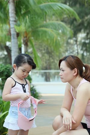 sulking: Woman comforting a sulking girl