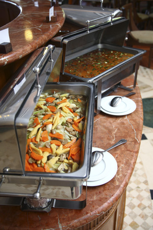 chafing dish: Buffet food in chafing dish