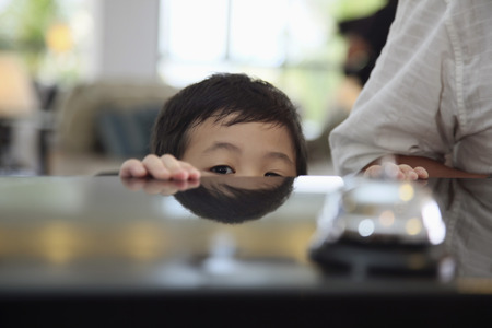 reception table: Boy peeping from under the reception table