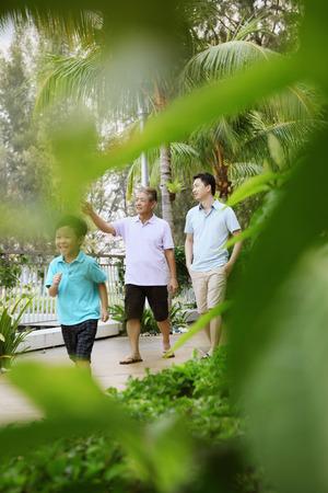 stroll: Men and boy taking a stroll down the promenade
