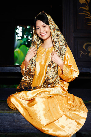 traditional clothing: Woman in traditional clothing smiling
