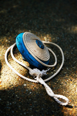 Blue top with string on the ground