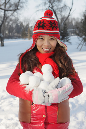 snowballs: Woman with an armful of snowballs