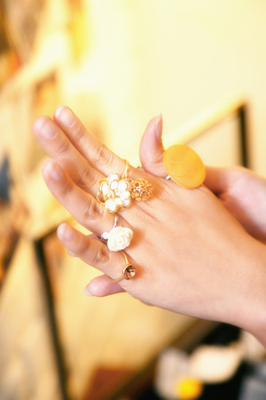 woman's hand: Womans hand wearing assortments of rings