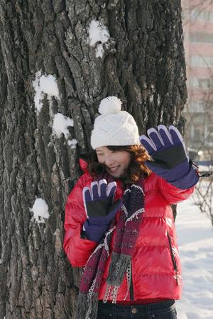 shielding: Woman shielding herself from snowball