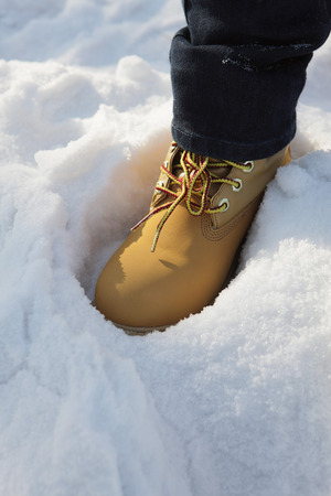 stepping: Woman stepping on snow