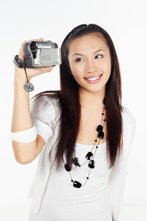 home video camera: Woman using home video camera LANG_EVOIMAGES