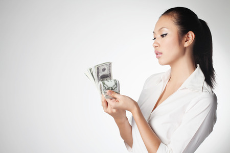 corporate greed: Businesswoman counting money