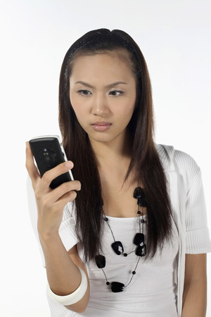 Woman text messaging on mobile phone Stock Photo