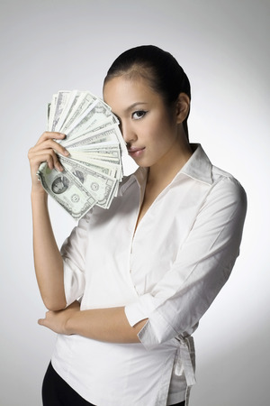 corporate greed: Businesswoman holding money