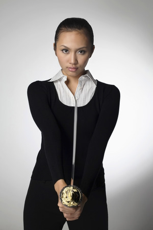 samurai sword: Woman holding samurai sword