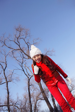 warm clothing: Woman in warm clothing smiling
