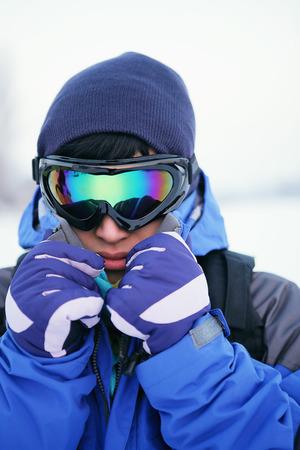 ski goggles: Man in warm clothing and ski goggles