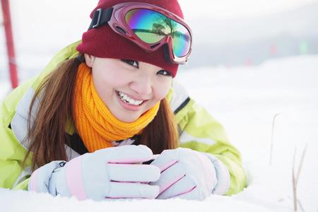 lying forward: Woman lying forward in snow