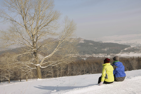 Man and woman enjoying the view on winter day