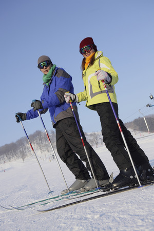 affectionate action: Man and woman skiing