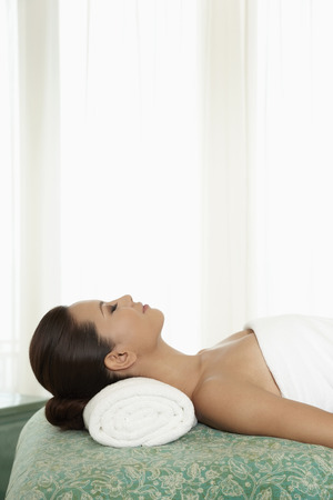 massage  table: Woman lying on massage table
