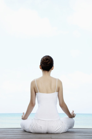 woman meditating: Woman meditating LANG_EVOIMAGES