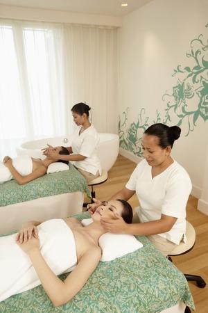 Women enjoying facial massage