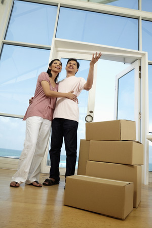 cardboard only: Man and woman looking at their new house