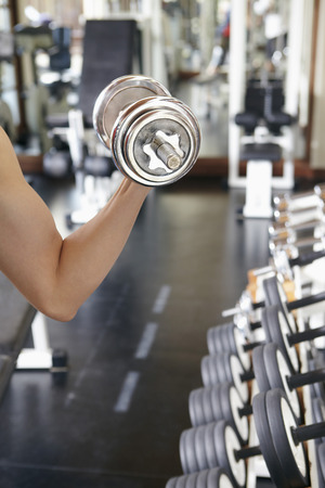 lifting weights: Man lifting weights in gym