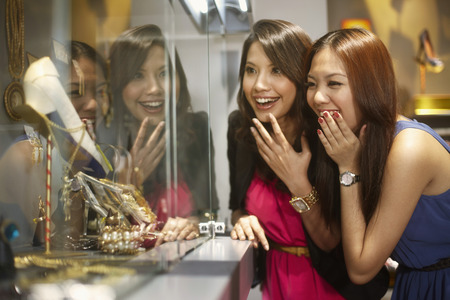Women window shopping together