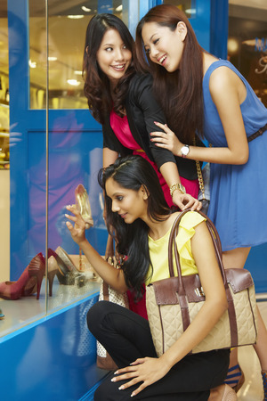 only three people: Women window shopping together
