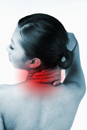 rubbing: Woman rubbing sore neck