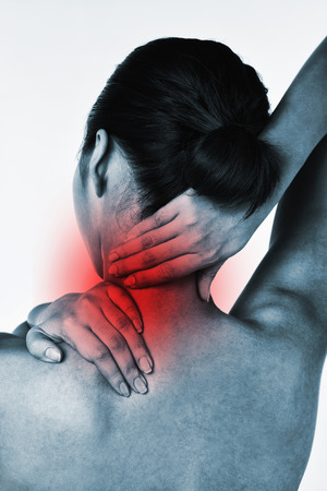 rubbing: Woman rubbing sore neck and shoulder LANG_EVOIMAGES