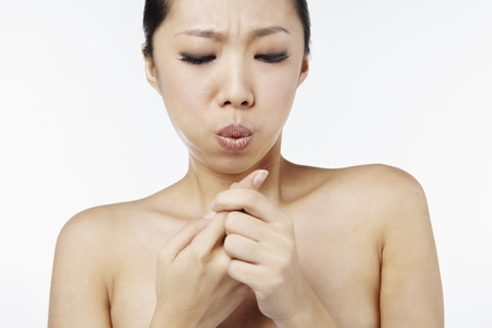 woman blowing: Woman blowing on finger injury LANG_EVOIMAGES
