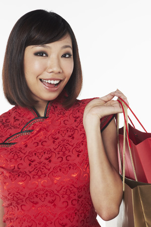 qipao: Woman in traditional clothing carrying shopping bags