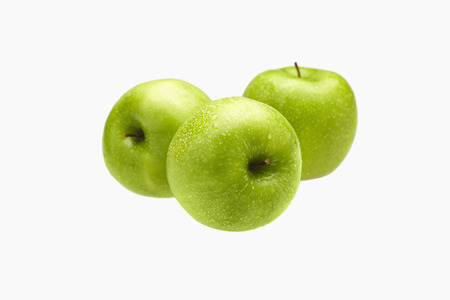 health conscious: Green apples with water droplets LANG_EVOIMAGES