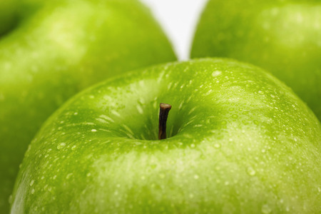 green apples: Close-up of green apples with water droplets LANG_EVOIMAGES
