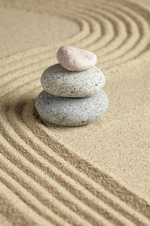 raked: Three stones stacked on raked sand LANG_EVOIMAGES