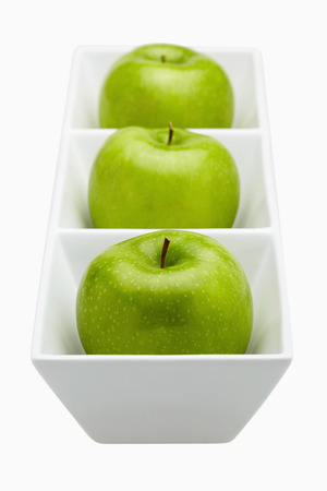 health conscious: Green apples placed in a ceramic dish LANG_EVOIMAGES