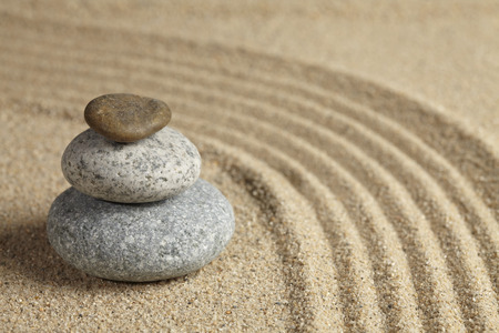 stacked up: Three stones stacked up in rock garden LANG_EVOIMAGES