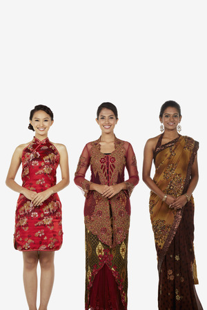 three people only: Women in traditional clothing smiling happily LANG_EVOIMAGES