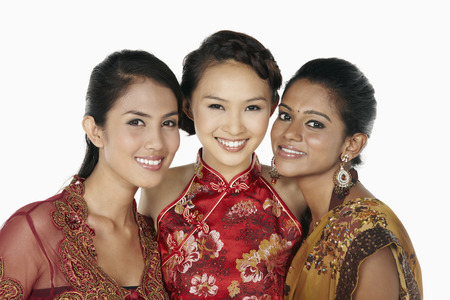 Happy women in traditional clothing smiling