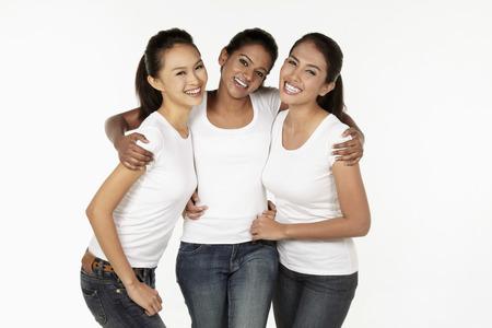 Three happy women smiling