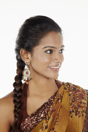 sari: Woman in sari smiling and looking away