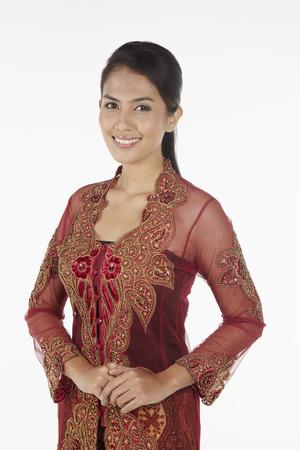 Woman in baju kebaya smiling at the camera