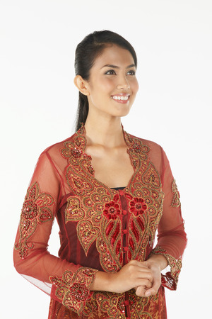 hands clasped: Woman in baju kebaya smiling with her hands clasped