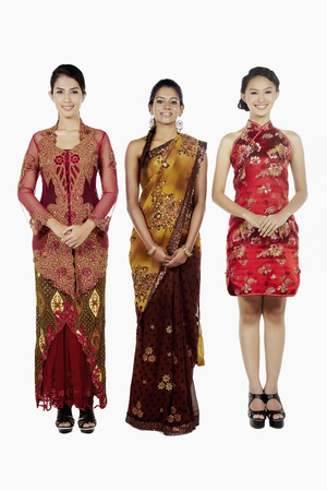 three people only: Happy women in traditional clothing smiling