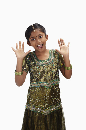 kameez: Surprised girl in traditional clothing with hands opened