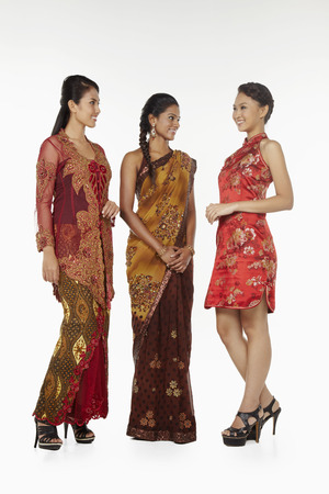 traditional clothing: Happy women in traditional clothing smiling