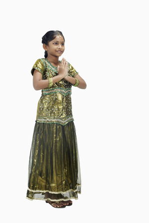 kameez: Girl in traditional clothing with greeting hand gesture LANG_EVOIMAGES