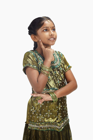 kameez: Girl in traditional clothing contemplating
