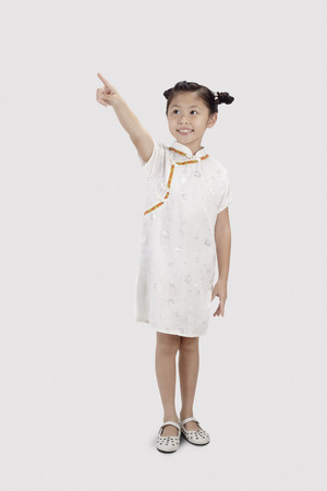 cheongsam: Girl in cheongsam smiling and pointing with finger