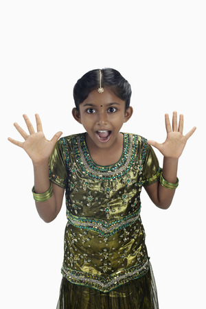 kameez: Girl in traditional clothing looking shocked with hands opened