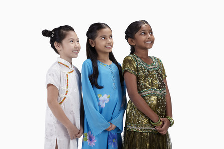 kameez: Girls in traditional clothing smiling with hands clasped LANG_EVOIMAGES